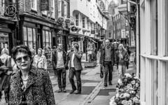 Wandering through the streets of York. (steve.gombocz) Tags: street bw blackwhite noiretblanc zwartwit streetphotography olympus greyscale bwphoto noirblanc negroyblanco svarthvitt negroblanco olympuscamera nerobianco sortoghvid svartochvitt streetblackandwhite schwartzundweiss flickrstreet flickrblackandwhite olympusm25mmf18 olympusem5mark2
