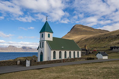 A Church by the Sea (Aymeric Gouin) Tags: faroe faroeislands fro ilesfro gjgv church glise froyar northerneurope europe landscape paysage paisaje landschaft seascape sea mer ocean atlantic atlantique mountain eysturoy town village nature light lumire travel voyage olympus omd em10 aymgo aymericgouin architecture