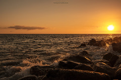 The End Of The Beginning (Fredrik Lindedal) Tags: ocean rocks water wave sun sunlight sunset clouds sky skyline harmony beautiful earth nikon fredriklindedal onewithnature landscape seascape sea serene coast