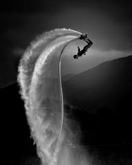 Swan Dive (davidandsus) Tags: blackandwhite water mono upsidedown queenstown flyboarding
