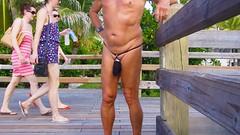 black baggie strap boardwalk (bmicro2000) Tags: man male beach public thong tiny gstring bungee baggie minimalswimwear microkini microbeachwear
