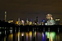 Fireworks over Central Park (spurekar) Tags: newyorkcity newyork skyline fireworks centralpark empirestatebuilding jacquelinekennedyonassisreservoir
