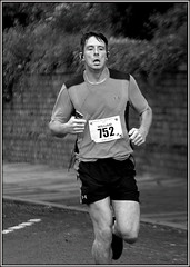 No gain without pain (* RICHARD M (Over 6 million views)) Tags: street sports speed mono concentration blackwhite pain action candid william grimace effort determined athlete southport halfmarathon sportsman determination merseyside competitor sefton nopainnogain roadracing inthezone longdistancerunning strained roadracer truegrit longdistancerunner lonelinessofthelongdistancerunner southporthalfmarathon halfmarathonrunner