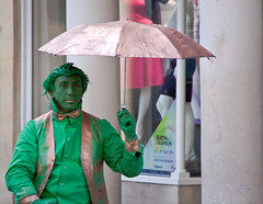 Green Street Performer with an Umbrella - Bath Spa, UK (ChrisGoldNY) Tags: chrisgoldny chrisgoldberg chrisgold chrisgoldphotos chrisgoldphoto albumcover albumcovers posters poster bookcover bookcovers jaunted gridskipper travel viajes uk unitedkingdom greatbritain britain british england english bath green people performers funny quirky strange weird bizarre umbrella colorful colourful colors costumes street streetscenes men bowties shiny wigs makeup bathspa eu europe europa european postcards life warmth alive greetingcards