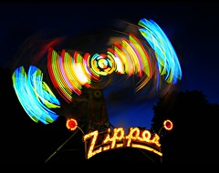 Keep It Zipped (floralgal) Tags: longexposure carnival colorful amusementpark lighttrails amusementride portchesternewyork corpuschristicarnival2013