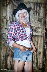 Louise O'Brien_D7K8905 (sparkeyb) Tags: sexy female barn 35mm iso100 model nikon cowgirl cowboyhat equestrian strobe stables speedlite offcamera tengallonhat strobist d7000 sb700 sparkeyb