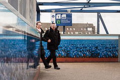 Hand in hand (glukorizon) Tags: blue plant flower reflection art station sign walking photo blauw foto hand angle many candid kunst nederland delft railwaystation tulip lopen centrum bord bloem manandwoman loopbrug gangway odc zuidholland hoek tulp reflectie veel spiegeling aroundthecorner odc1 manenvrouw informationsign informatiebord ourdailychallenge