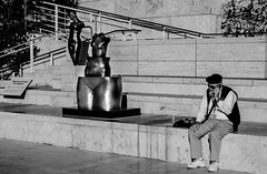 Man and Statues (mikeyt25) Tags: california usa white man black art statue rock stone america beard los sitting phone angeles united steps hollywood getty states talking
