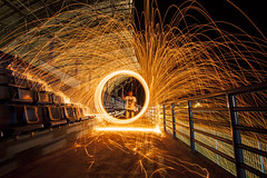 playing with fire in a football stadium (Manyund Photography) Tags: lighting longexposure light boy night digital speed canon fire eos exposure shoot slow firework frame shutter stadion steelwool sangatta canoneos50d
