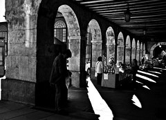 Market In Shadow (Christine Bloom) Tags: plaza people white black town spain nikon shadows mayor market centre arches salamanca buying d5000