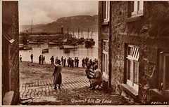 22501-34. Quaint Old St. Ives by Frank Lake (c.1934) (pellethepoet) Tags: england lighthouse beach architecture pier women cornwall artist unitedkingdom harbour postcard photograph lane fishingboats stives franklake westcornwall stivesharbour smeatonspier rppc realphotopostcard porthla