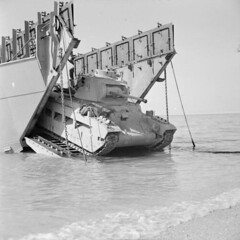 A Matilda tank comes ashore from a landing craft during combined operations training involving 5th New Zealand Infantry Brigade at Ras Sudr in Egypt, 9 February 1942.