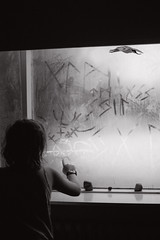 Learning the runic alphabet (Dalla*) Tags: boy portrait bird window writing iceland kid child finger reykjavik inside damp runes rnir runicalphabet dallais