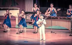 Performing To Perfection (Baron Reznik) Tags: school boy music cute girl smile fashion horizontal kid model child guitar culture bowtie palace korea eerie musical violin instrument fiddle musicalinstrument tambourine puto northkorea sodo flatland pyongyang  chosun changan dprk  stringinstrument  colorimage   ryugyong       democraticpeoplesrepublicofkorea       chosnminjujuiinminkonghwaguk mangyongdae  canon28300mmf3556lisusm   kisong  mangyongdaechildrenspalace   ryugyng pyeongyangjikhalsi mangyongdaeschoolchildrenspalace  hwangsong rakrang sgyong hogyong capitolofwillows pyngyangchikhalsi