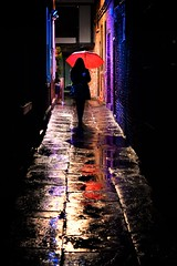 Umbrella (D.J. De La Vega) Tags: street york red reflection girl rain silhouette umbrella 50mm alley nikon df d candid f18