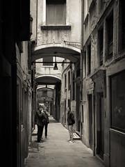 Talking the town (Raymond Kuilboer) Tags: venice people bw white black architecture blackwhite alley chinatown smoke smoking venezia venetie chinees