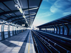 Blue Lines (tripowski) Tags: blue london mamiya film station train mediumformat 645 fuji tungsten dlr 45mm mamiya645 eastlondon 64t pontoondock mamiya645protl 45mmf28c