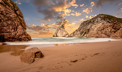 Ursa Sunset (LM-Jay) Tags: sunset sea beach portugal water clouds evening coast sand rocks long exposure lisbon cliffs atlantic da ursa praya