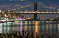 Manhattan Bridge (DSC01333) (Michael.Lee.Pics.NYC) Tags: longexposure newyork reflection night clouds cityscape sony manhattanbridge eastriver lighttrails pilings fdrdrive southstreet traffictrails a7rm2 fe70300mmg