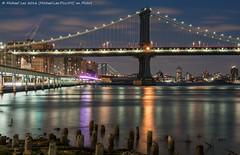 Manhattan Bridge (DSC01333) (Michael.Lee.Pics.NYC) Tags: longexposure newyork reflection night clouds cityscape sony manhattanbridge eastriver lighttrails pilings fdrdrive southstreet traffictrails a7rm2 fe70300mmg