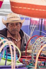 Basket Weaver (djking) Tags: man mexico market guadalajara jalisco baskets weaver cowboyhat marketday