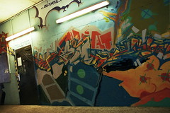 Untitled (SB Photographie) Tags: street camera old light brussels art film wall canon campus de graffiti paint neon colours belgium belgique couleurs tag universit tube corridor bruxelles graph peinture fluorescent lumiere a1 analogue 24mm rue mur libre couloir argentique fd plaine ulb analogique