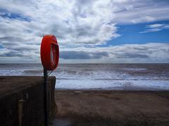 Lifebuoy (martin_rees) Tags: uk england seascape colour beach clouds coast seaside saturated waves devon promenade nik lifebuoy seaton colorefex