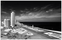 La Habana (kurtwolf303) Tags: city sky bw streets topf25 clouds contrast buildings dark topf50 topf75 500v20f cuba dramatic himmel wolken stadt sw caribbean kontrast gebude dunkel 800views kuba lahabana karibik 900views strasen dramatisch 750views 1000v40f 250v10f monochromefineart canoneos600d