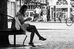 Girl sitting (MathijsvdLinden) Tags: street tree mobile person sitting sneakers