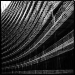 Abstract with sweeping iron curves (Justin Barrie Kelly) Tags: blackandwhite bw abstract lines photography rivets doubleexposure curves modernism squareformat abstraction geometrical ironwork dynamism girders blackandwhitephotography monolithic overlapping victorianengineering rolleiflex28c rivetted analoguefilm structuralsteelwork modernistphotography jbkelly caffenolcl justinbkelly justinbarriekelly cafenolcl