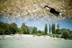 Munich (iampaulrus) Tags: 35mm filmisnotdead film istillshootfilm lomography lomo paulfargher paulfargherphotography lca multipleexposure doubleexposure splitzer munich river water beer bottles trees pebbles germany german