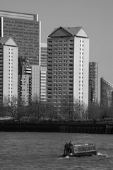 Big Adventure (marktmcn) Tags: city blackandwhite london tower dogs monochrome thames buildings river sailing blocks launch nikkor riverbank across isle barge 28300mm e14 se16 d610