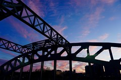 Sunset and Moon Through BU Bridge ((Jessica)) Tags: bridge sunset sky moon silhouette boston architecture clouds industrial massachusetts newengland crescentmoon pw bubridge
