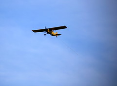 A prop plane carrying an ad soars over Manasquan Beach (apardavila) Tags: plane airplane jerseyshore manasquan propplane manasquanbeach