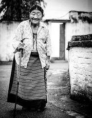 Happy... (~~SwaCha~~) Tags: old travel woman india color beautiful smile temple photography 50mm nikon peace dancing buddha enjoy ritual dehradun