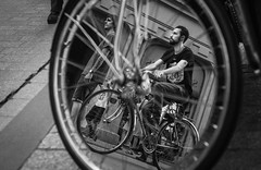 Inception (Vadim.Cojuhov) Tags: portrait people blackandwhite bw white man black film monochrome look bicycle wheel speed canon outside 50mm perspective machine like poland krakow whitebackground vista outlook chance incident promise fortuna steet 6d fortuity wheelman