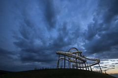 the sky above ' Tiger & Turtle ' (Blende1.8) Tags: blue sunset sculpture night clouds nikon cloudy turtle tiger hill wolken sigma skulptur illuminated explore hour duisburg 1224 achterbahn blaue hügel d600 beleuchtet stunde tigerturtle bestcapturesaoi elitegalleryaoi grosskulptur kulturhauptstad vigilantphotographersunite vpu2 vpu3 vpu4 vpu5 vpu6 vpu7 vpu8 vpu9