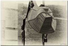 Locked hat (Juan R. Martos) Tags: hat gorro hanging desaturated sombrero hang colgado candado bloqueado desaturado