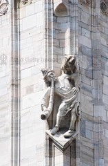Duomo di Milano -  detail (Sebastian Condrea) Tags: travel people sculpture white milan color building tourism church monument statue architecture facade religious outdoors photography ancient worship europe european day catholic exterior place cathedral symbol no basilica milano traditional details faith religion style panoramic architectural spire master di christianity marble duomo ornate renaissance masterpiece monumental lombardy destinations
