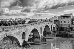 Puente la Reina (spanishjohnny72) Tags: road old travel bridge sky storm building history tourism water architecture clouds river outside outdoors town spain europe arch landmark historical puentelareina spagna navarra