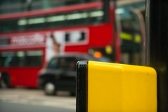 Yellow thing (aistora) Tags: life street city uk red england urban abstract black blur color colour bus london wet westminster weather yellow electric movement focus day dof traffic cloudy bokeh box britain vibrant cab taxi sony vivid overcast victoria sharp busy impressionism electrical primary impression impressionist unsharp lightroom victoriastreet defocus nex 1650 motin maistora 5r 1650mm yahoo:yourpictures=weather
