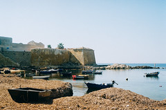 untitled (sympheria) Tags: sea summer italy film analog 35mm palms boats coast kodak sicily trapani olimpus