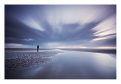 Cloud Cover (A-D-Jones) Tags: blue sea seascape beach pool statue clouds liverpool landscape puddle sand long exposure purple angle wide magenta cast gormley crosby merseyside sefton blundellsands