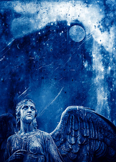 An angel in blue and white