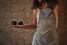 Cupcake Girl (Nourhan Refaat Maayouf) Tags: food brown selfportrait sexy texture kitchen girl self vintage dark baking scary nikon chocolate feminine creepy apron cupcake flies dslr brownhair rottenfood chocolatecupcakes brownwig wallpapertexture nikond5000 foodaffair