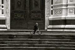 Cycling in Santa Croce [EXPLORE] (Antonio Cinotti ) Tags: blackandwhite bw italy bike bicycle florence blackwhite nikon italia child explore tuscany firenze toscana tamron biancoenero bicicletta santacroce d7100 nikond7100