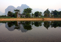 Nam Song River Mirror (pietkagab (on the road)) Tags: trip morning travel trees mountains reflection water canon river photography bush asia bank exotic backpacking shore fields laos vangvieng namsong mygearandme mygearandmepremium mygearandmebronze