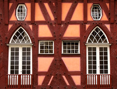 Half-timbered House (Batikart) Tags: wood old city travel windows summer vacation urban white holiday building lines architecture canon reflections germany square geotagged outdoors deutschland europa europe day doors stuttgart alt sommer fenster urlaub citylife salmon july haus auburn medieval symmetry stadt architektur historical townhall railing ursula rathaus holz weiss m