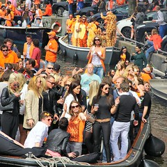 Revelers in Amsterdam celebrating Queens Day, which has been renamed Kings Day. (Bn) Tags: street girls party feest people music orange holiday holland boys water netherlands beer colors dutch amsterdam festival heineken fun boat dance topf50 kiss kissing king singing dancing market smoke tiger free floating kingdom swing canals celebration national trendy muziek carnaval prinsengracht alexander mokum meisjes gezellig amstel maxima willem jordaan oranje crowded straat tijgertje feestdag grachtengordel panden 50faves koningsdag kingsday 26april dansmuziek