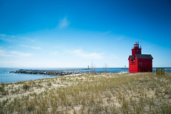 Big Red Holland MI (joshuay04) Tags: blue red sky lighthouse lake holland history beach water beauty coast harbor sand bright michigan sony ottawa may peaceful sunny a7r ilce7r